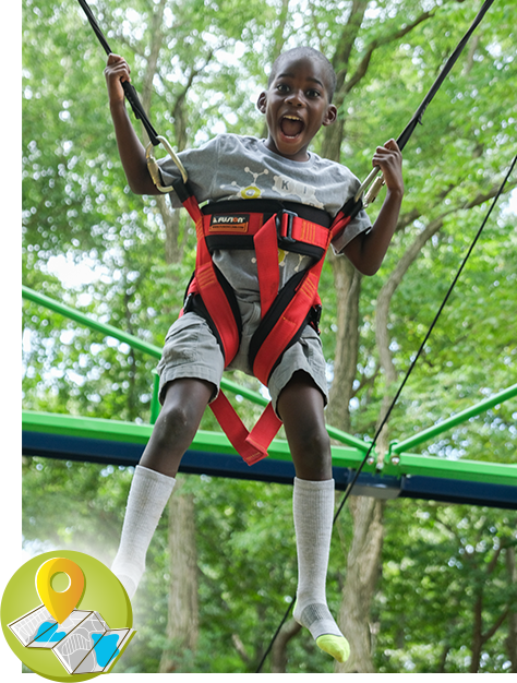 A boy on a ropes course