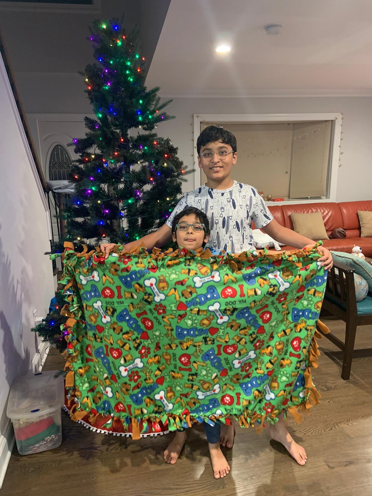 "Commonpoint Queens Thanks Ponce Bank for a $1000 Grant and Shrimad Rajchandra Love and Care Queens for a grant of $1200 in support of Making ""no-sew"" fleece blankets for children in need for Chanukah and Christmas"